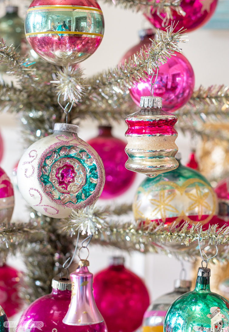 pink and green Shiny Brite ornaments on a tinsel tree