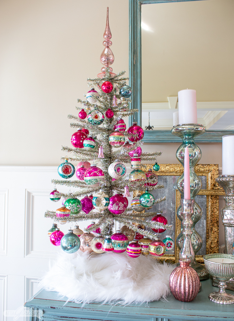 silver tinsel tree decorated with pink and green Shiny Brite Christmas ornaments