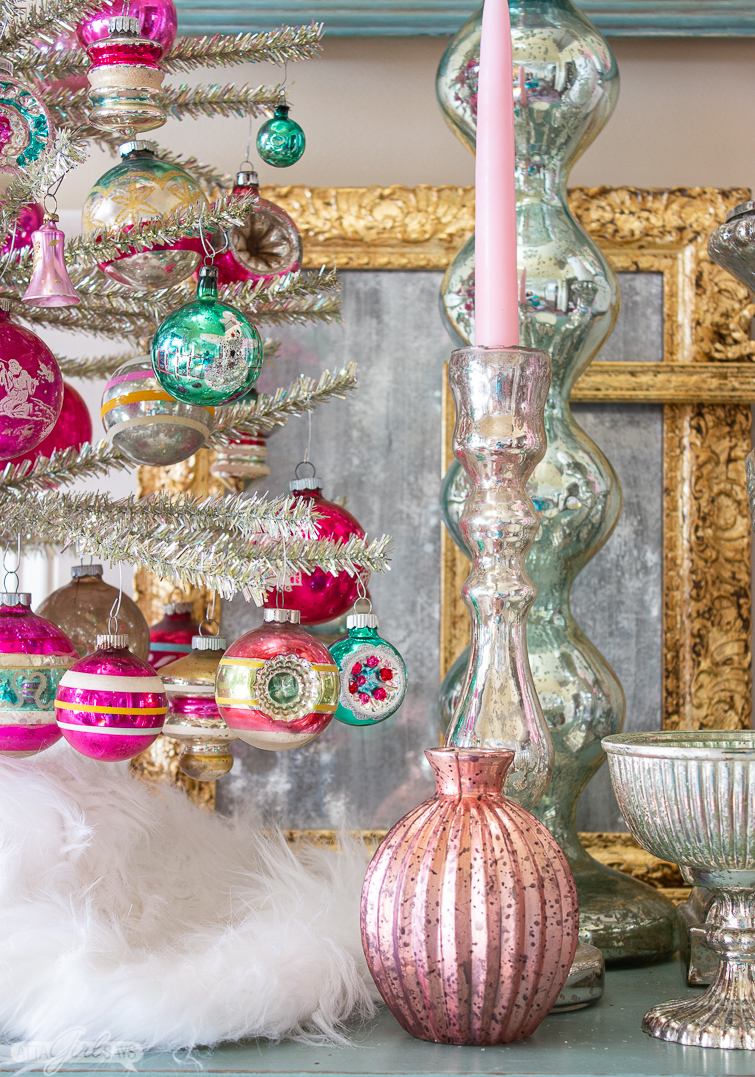 pink mercury glass vase beside a silver tinsel tree decorated with vintage Shiny Brite ornaments