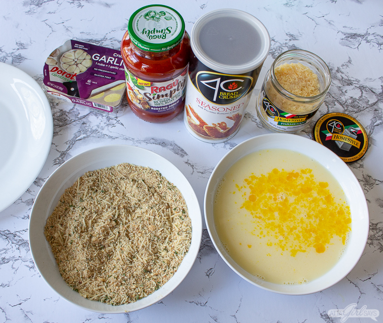 bread crumbs, egg wash and ingredients to make fried ravioli
