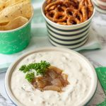 football party food spread with tortilla chips, pretzels and homemade French onion dip