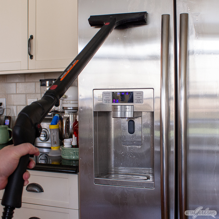 cleaning a stainless steel refrigerator with a steamer