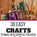 pencils, scissors, paintbrushes and other craft supplies in jars