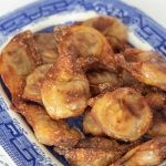 cirspy air fryer wontons on a blue willow plate