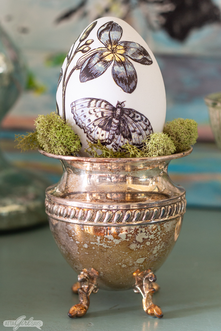 Easter egg with butterfly and vintage flower botanical design