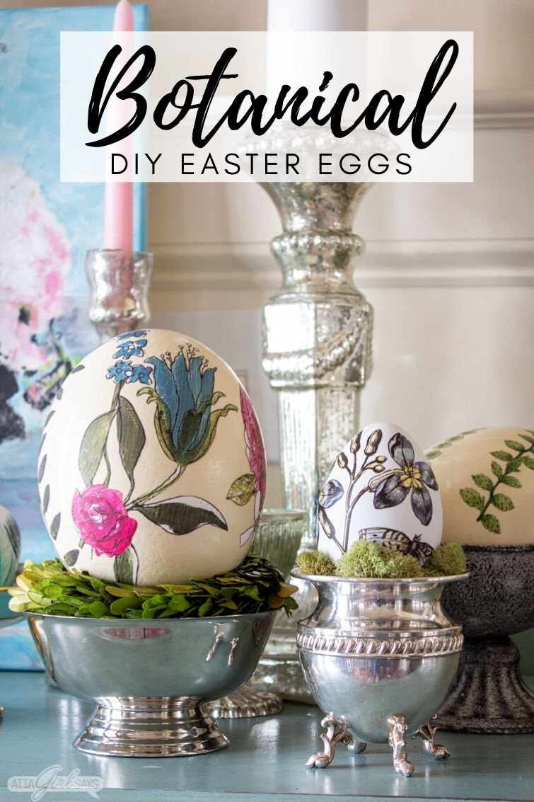 display of botanical decorated Easter eggs in silver with mercury glass candles in the background
