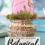 pink painted Easter egg with vintage botanical design in a silver cup with moss