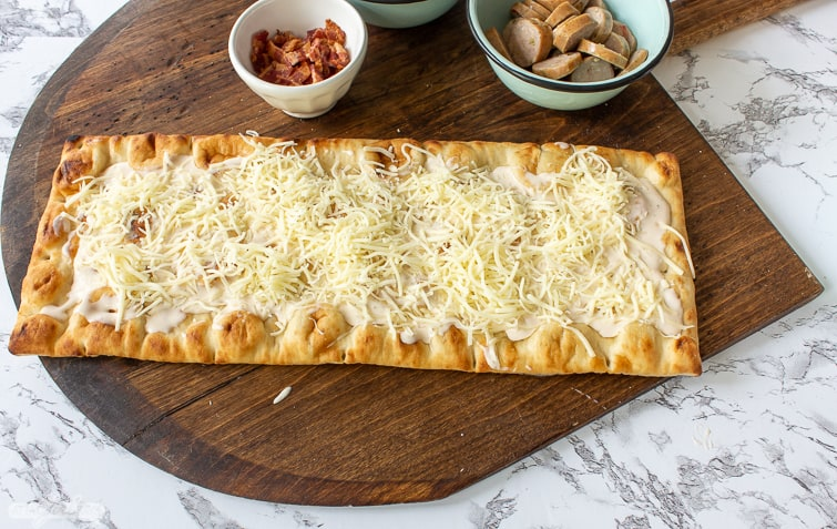 cheese on a flatbread pizza crust