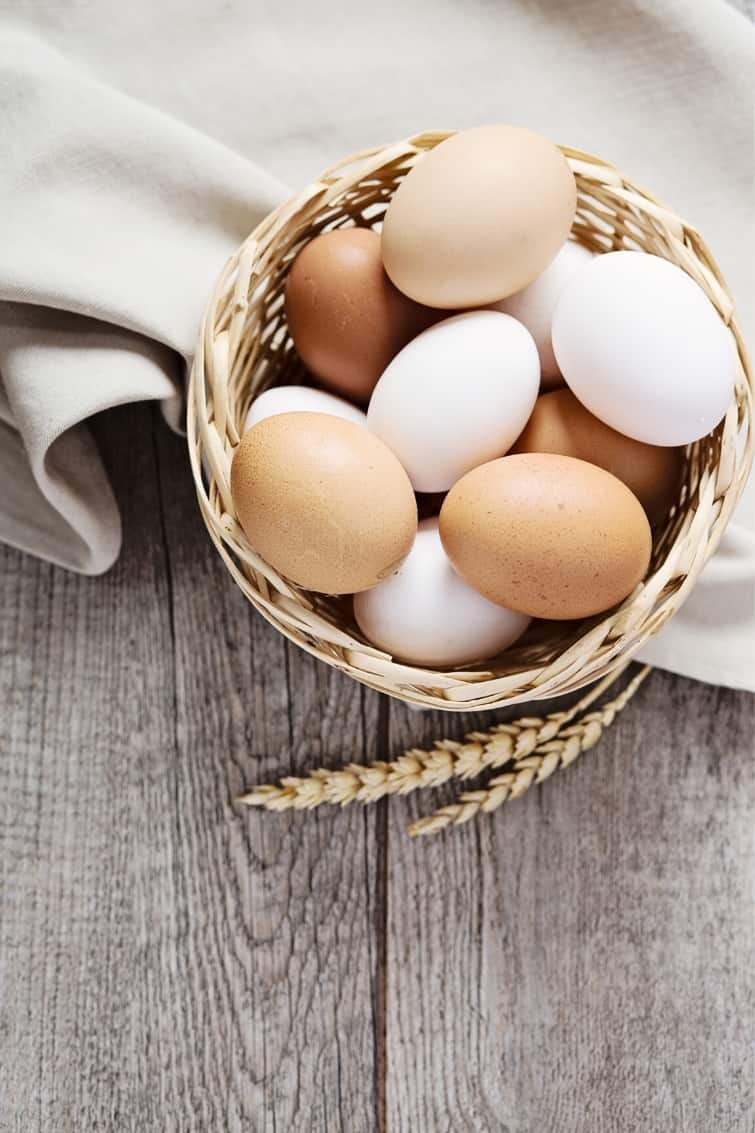 basket of eggs on a kitchen towel