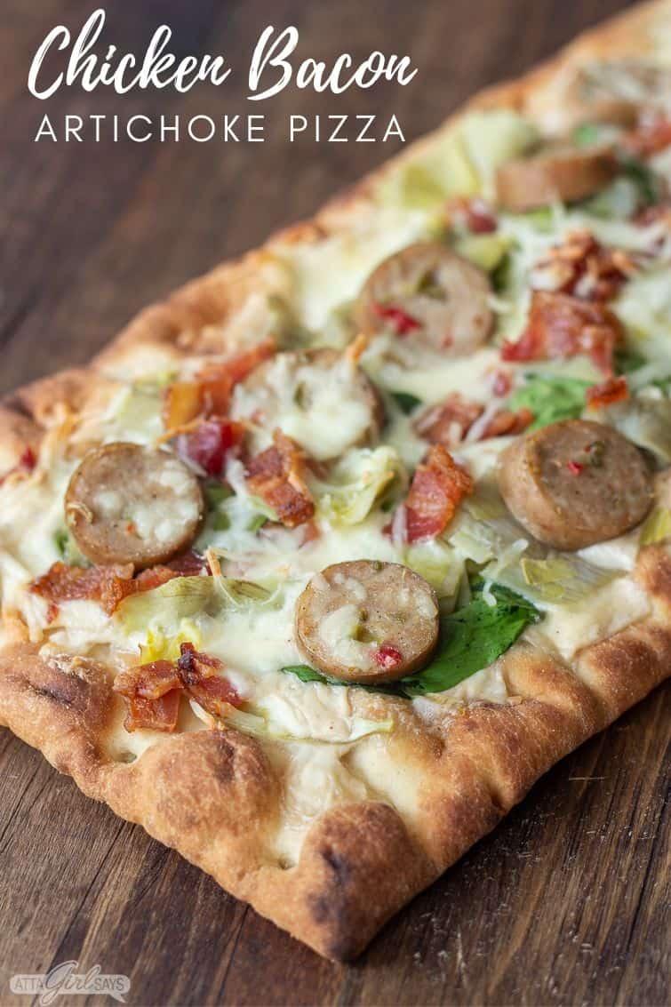 chicken bacon artichoke pizza on a pizza peel