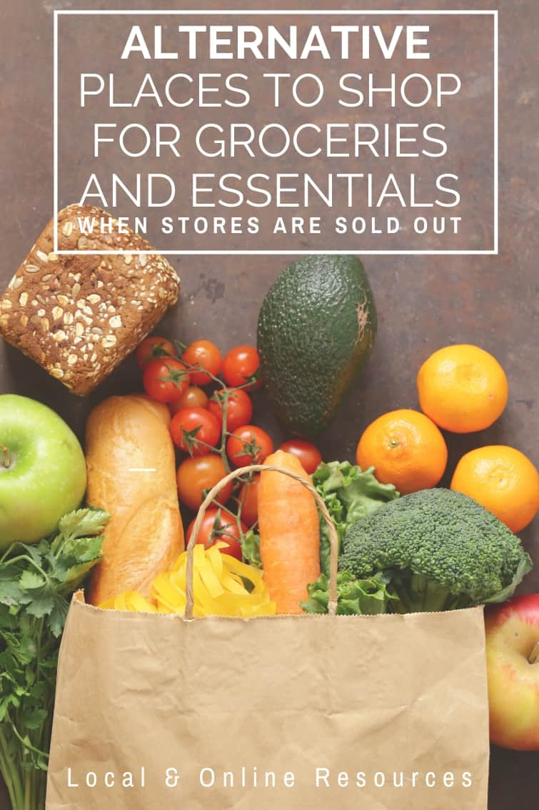produce and groceries coming out of a paper grocery bag