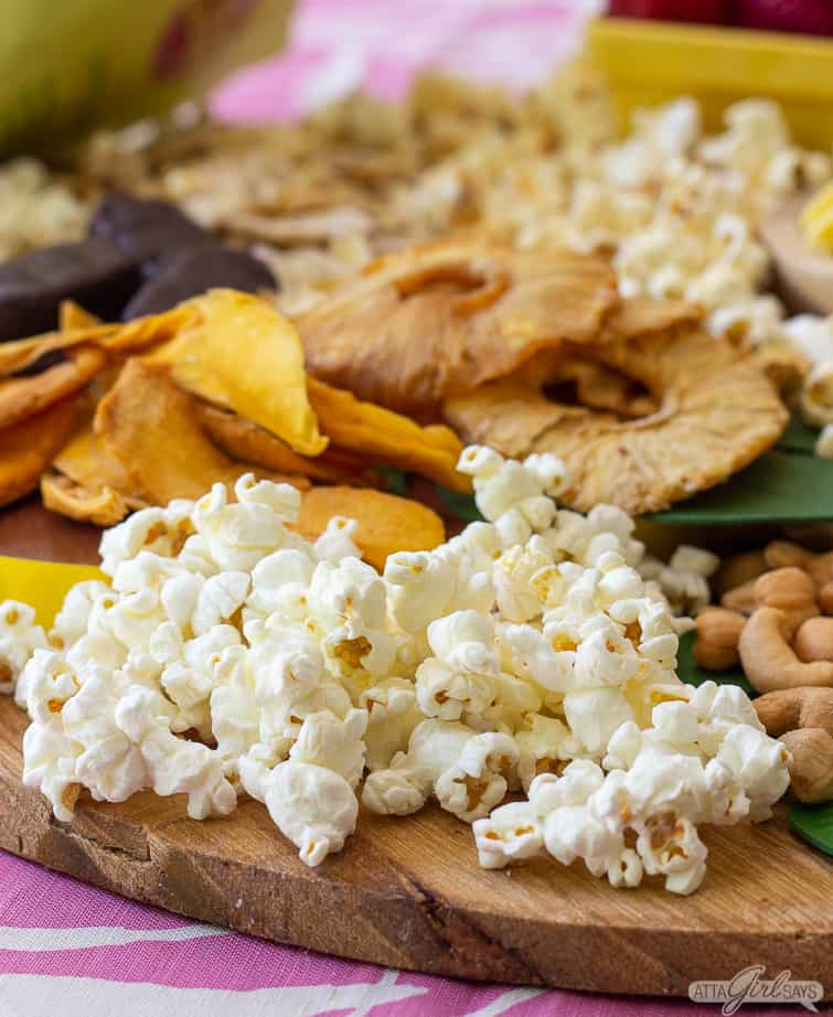 sea salt popcorn on a tropical charcuterie board