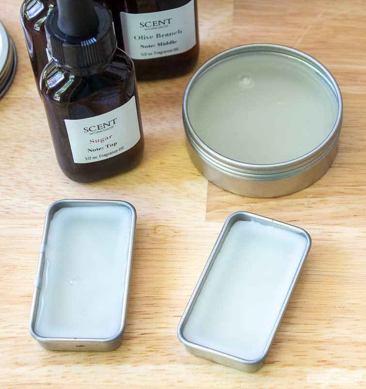 solid perfume in metal tins