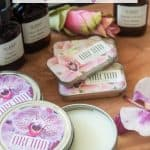 tins of homemade solid perfume with orchid fragrance oil