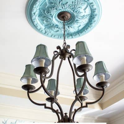 chandelier with blue shades and painted ceiling medallion