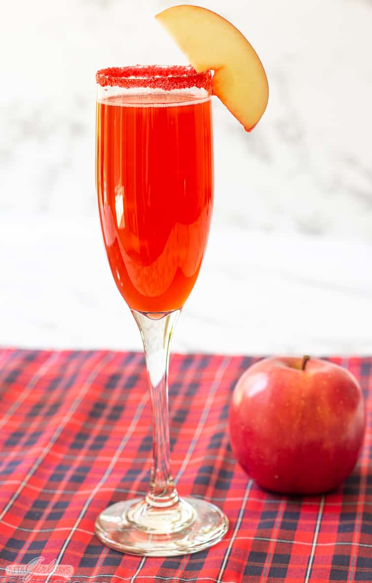 cinnamon apple cider cocktail in a champagne glass