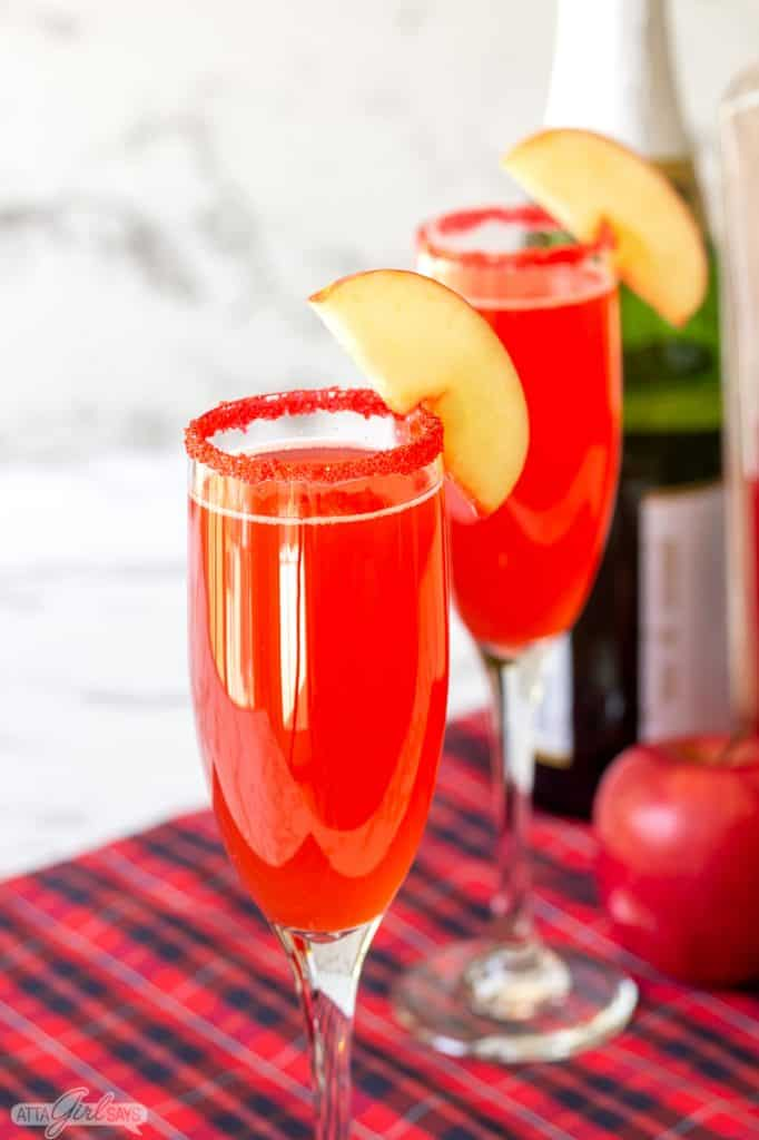cinnamon apple cider mimosa in a fluted champagne glass