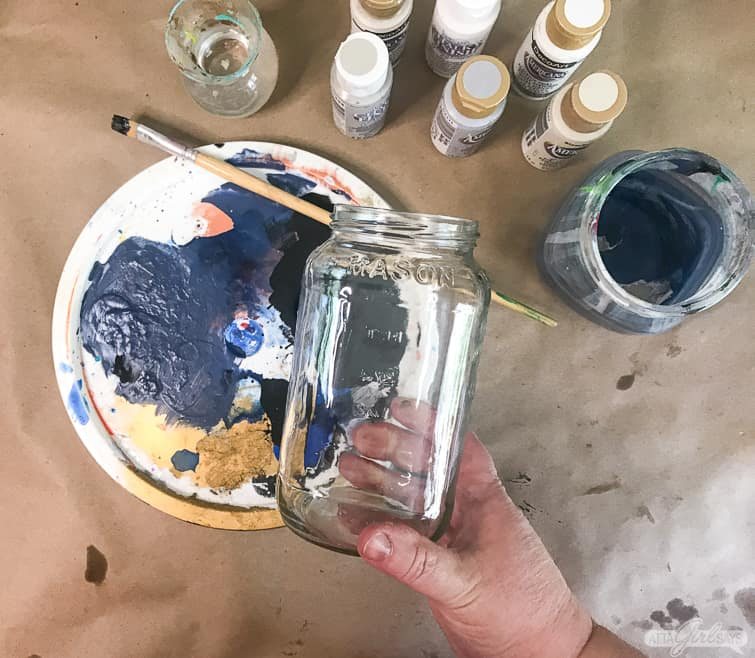 getting ready to paint an empty spagnetti jar