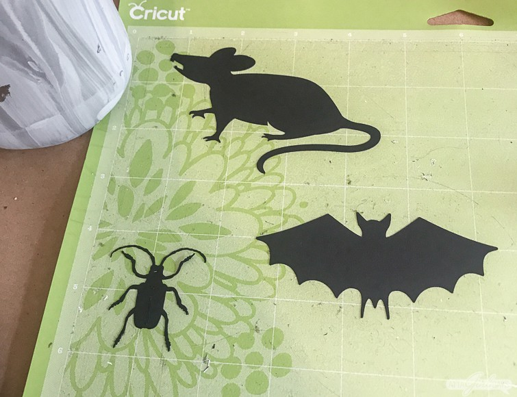 mouse, bat and beetle die cuts on a Cricut cutting mat