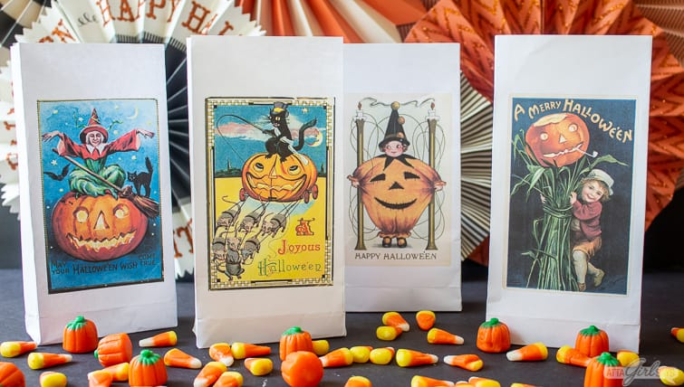 paper trick or treat bags featuring vintage Halloween postcard art