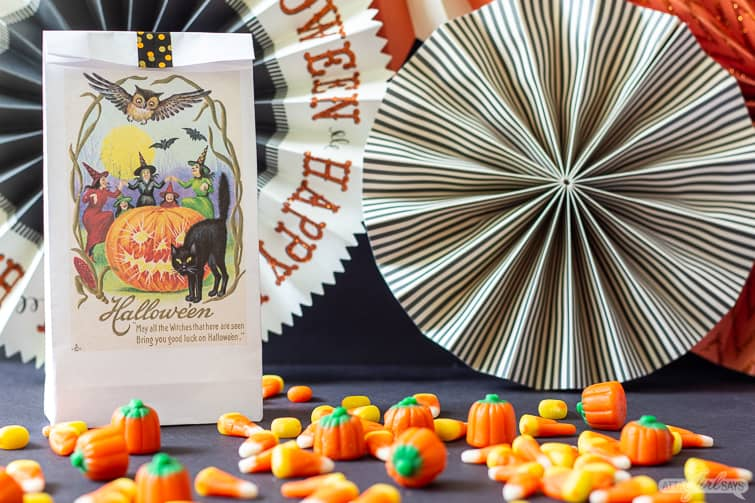 Halloween treat bag with a cat and jack o lantern surrouneded by candy corn