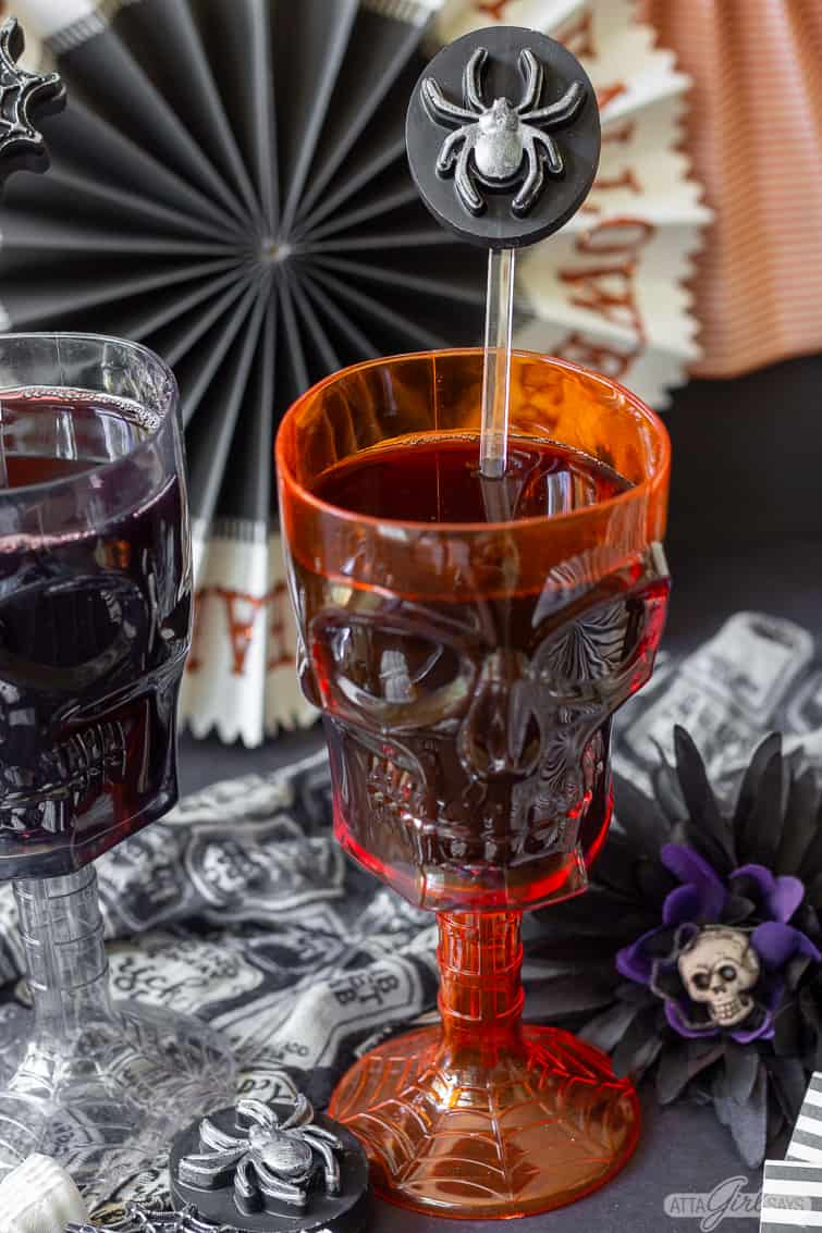 spider Halloween docktail stirrer in a skull goblet