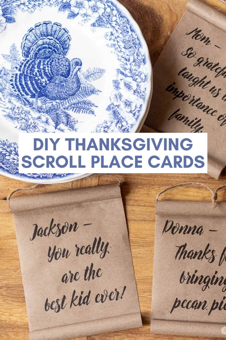 mini farmhouse scrolls and a blue and white turkey plate surrounded by DIY Thanksgiving place cards