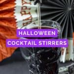 spiderweb cocktail swizzle stick in a skull goblet