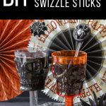 two skull goblets in front of Halloween banners