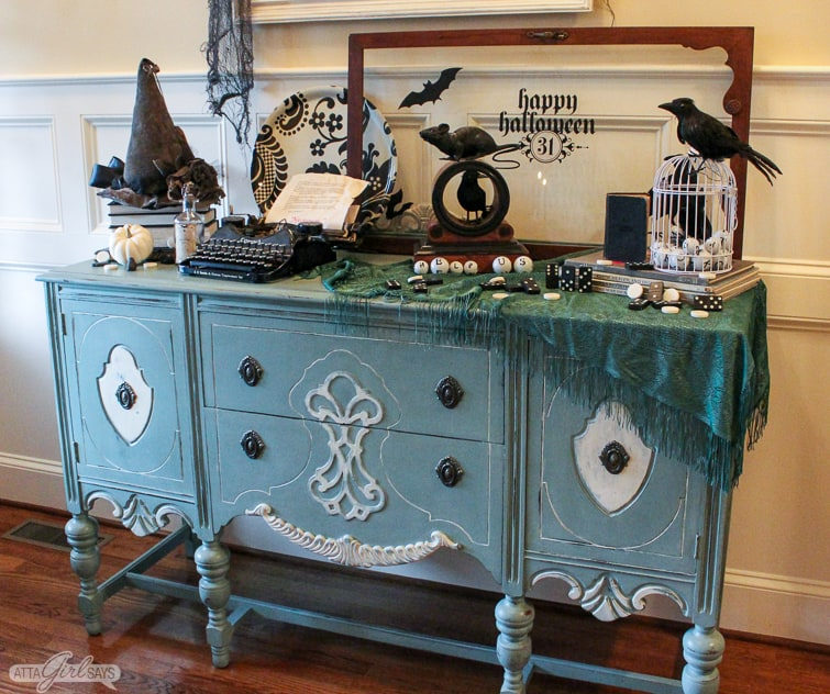 duck egg blue buffet decorated with vintage items for Halloween