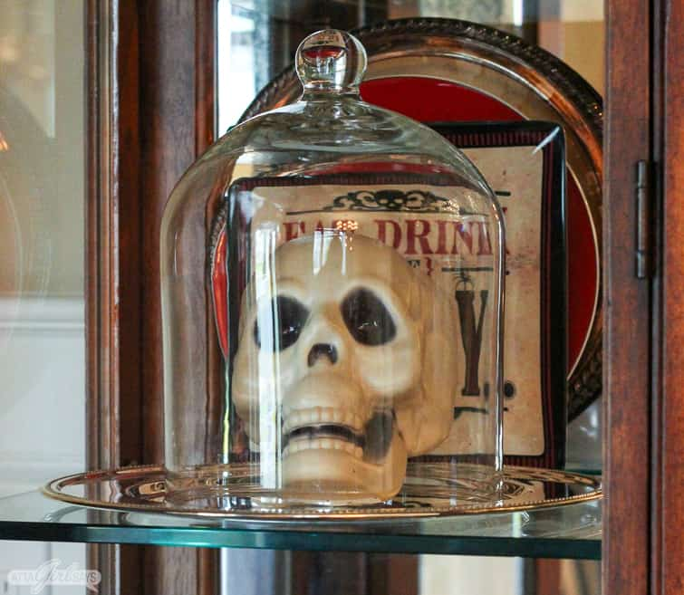 plastic skeleton under a glass cloche vintage Halloween decorations