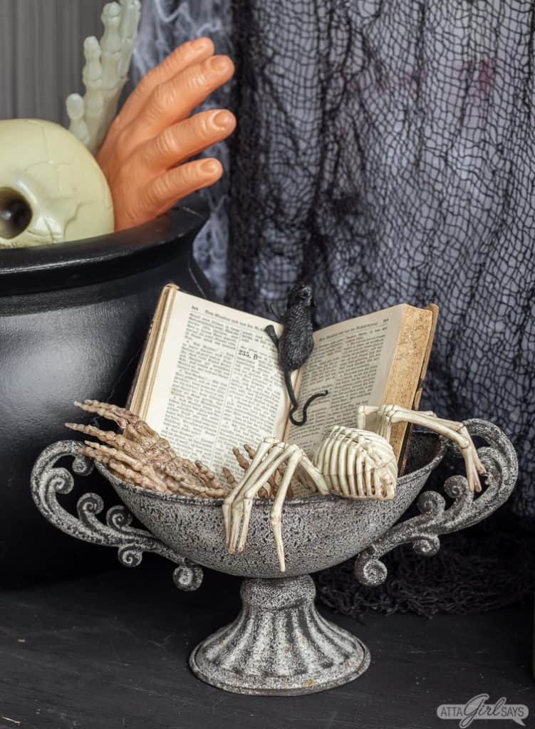 spell book and skeletons Halloween decor