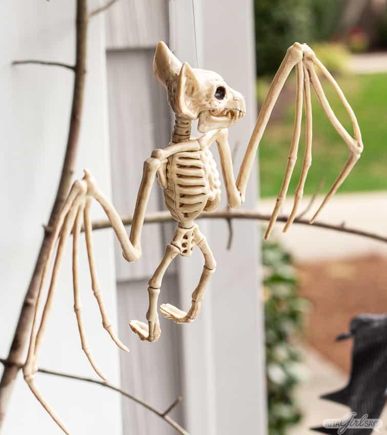 Halloween bat skeleton hanging from branches