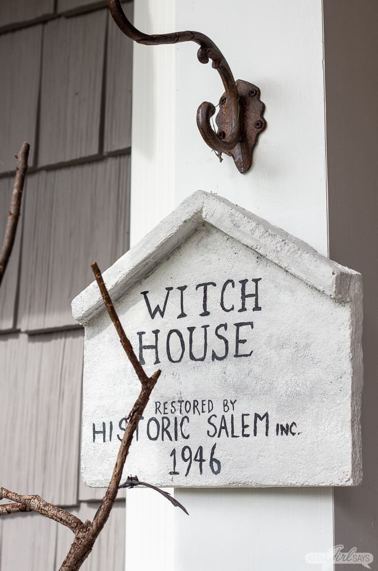 Salem Witch House replica sign hanging from a hook