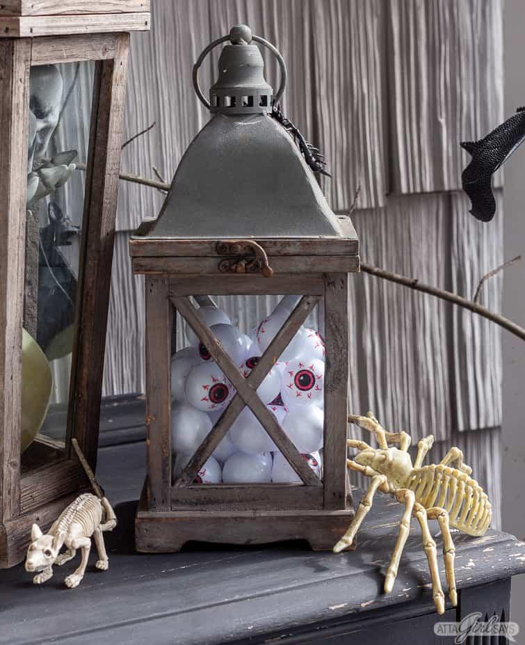 plastic eyeballs in a wooden lantern for Halloween