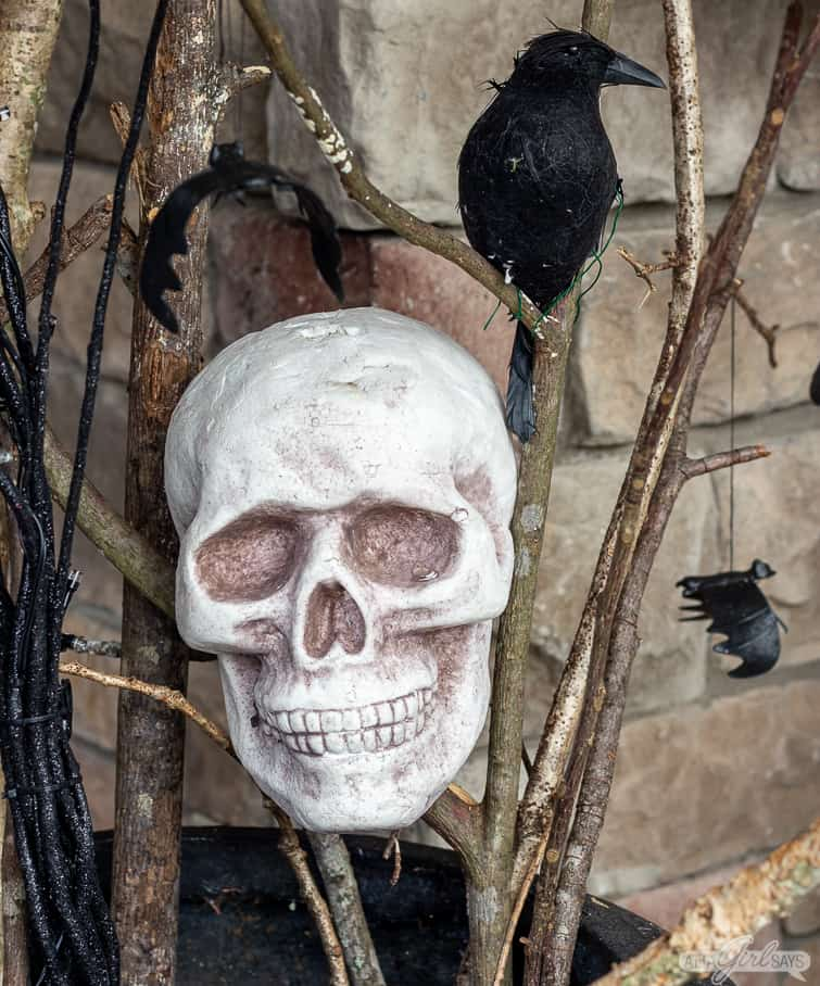 foam skull and crows on a Halloween front porch