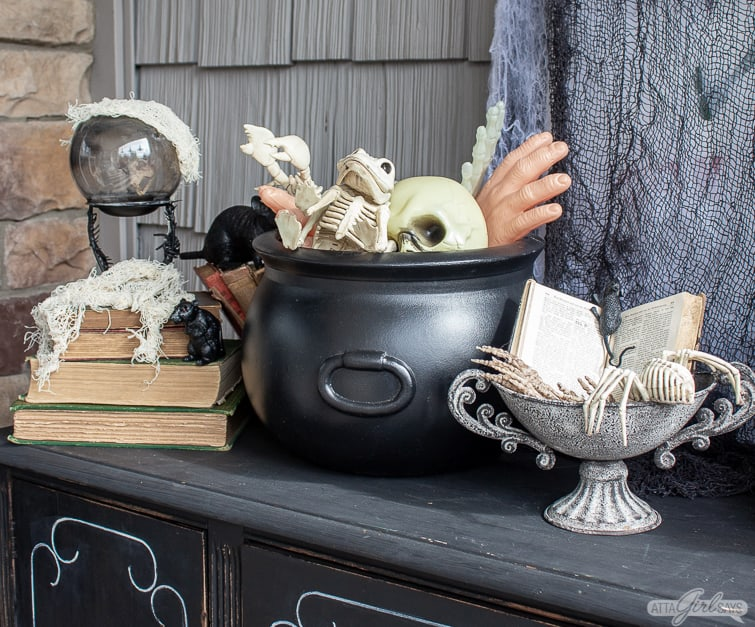 cauldron and crystal ball and witch's spell book Halloween decorations