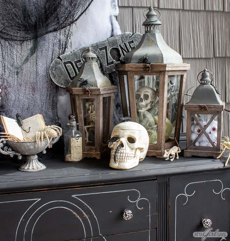 wooden lanterns filled with skulls and other Halloween decorations