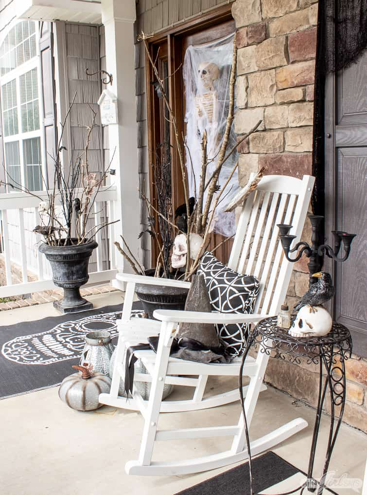 Halloween front porch decor with rocking chair and urns filled with sticks