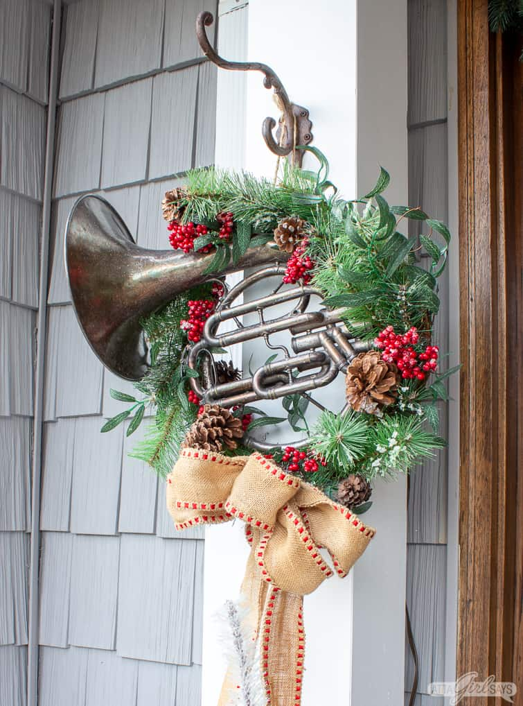 french horn on a holiday wreath