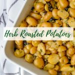 roasted potatoes with capers and olives in a white baking dish