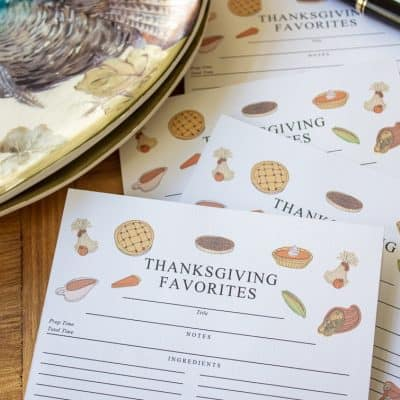 stack of Thanksgiving recipe cards beside a plate