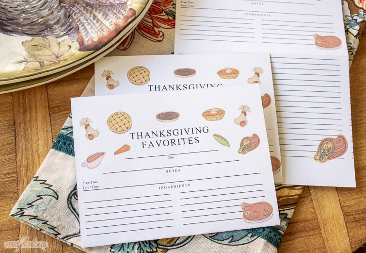 folded printable recipe cards beside a Thanksgiving plate