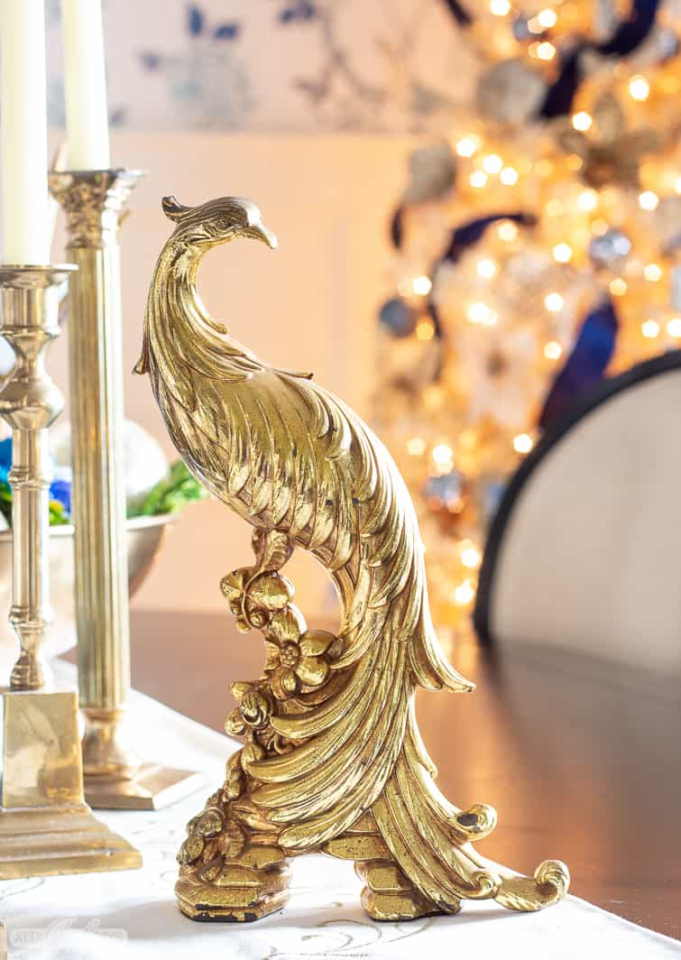 vintage gold pheasant figurine with a gold Christmas tree in the backgroun