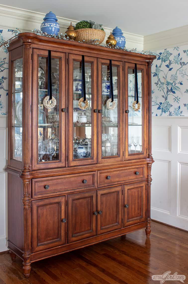 French style china cabinet with glass doors decorated for Christmas