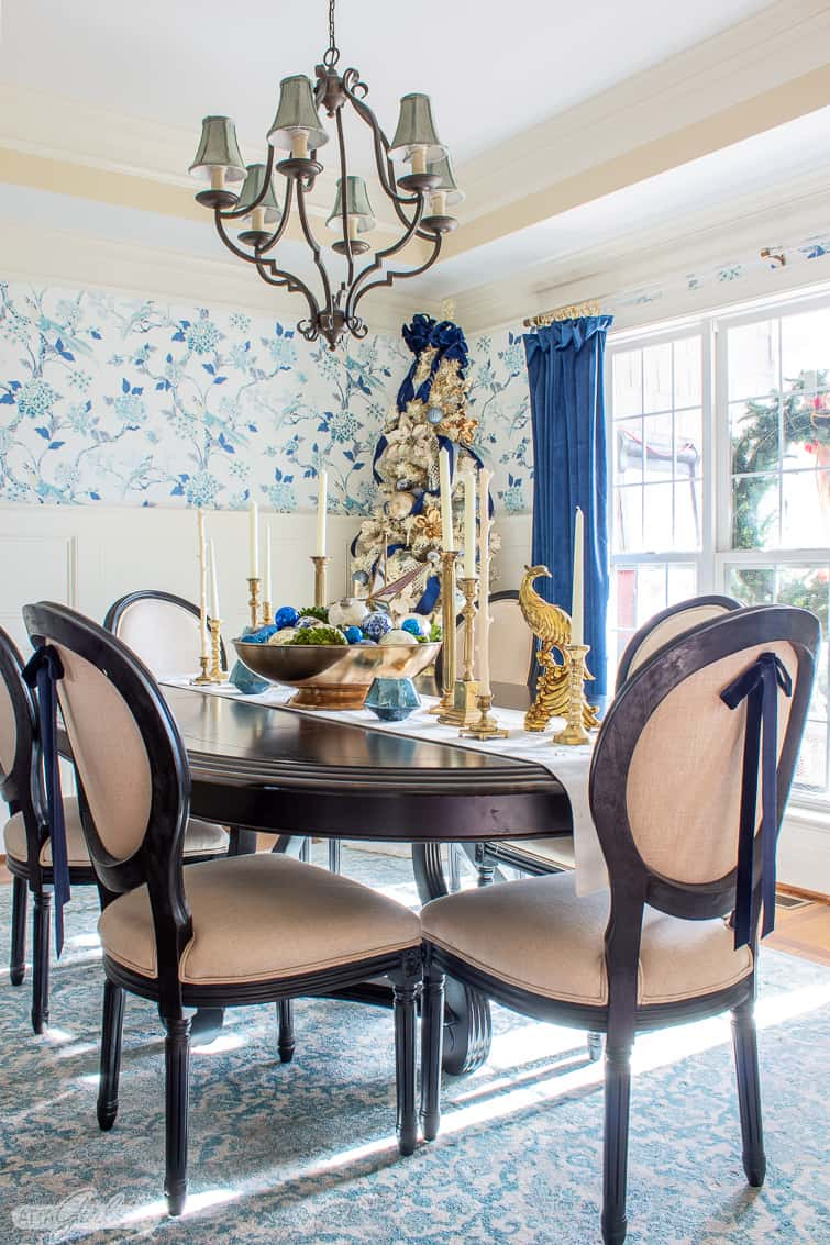 formal dining room decorated for Christmas with blue chinoiserie