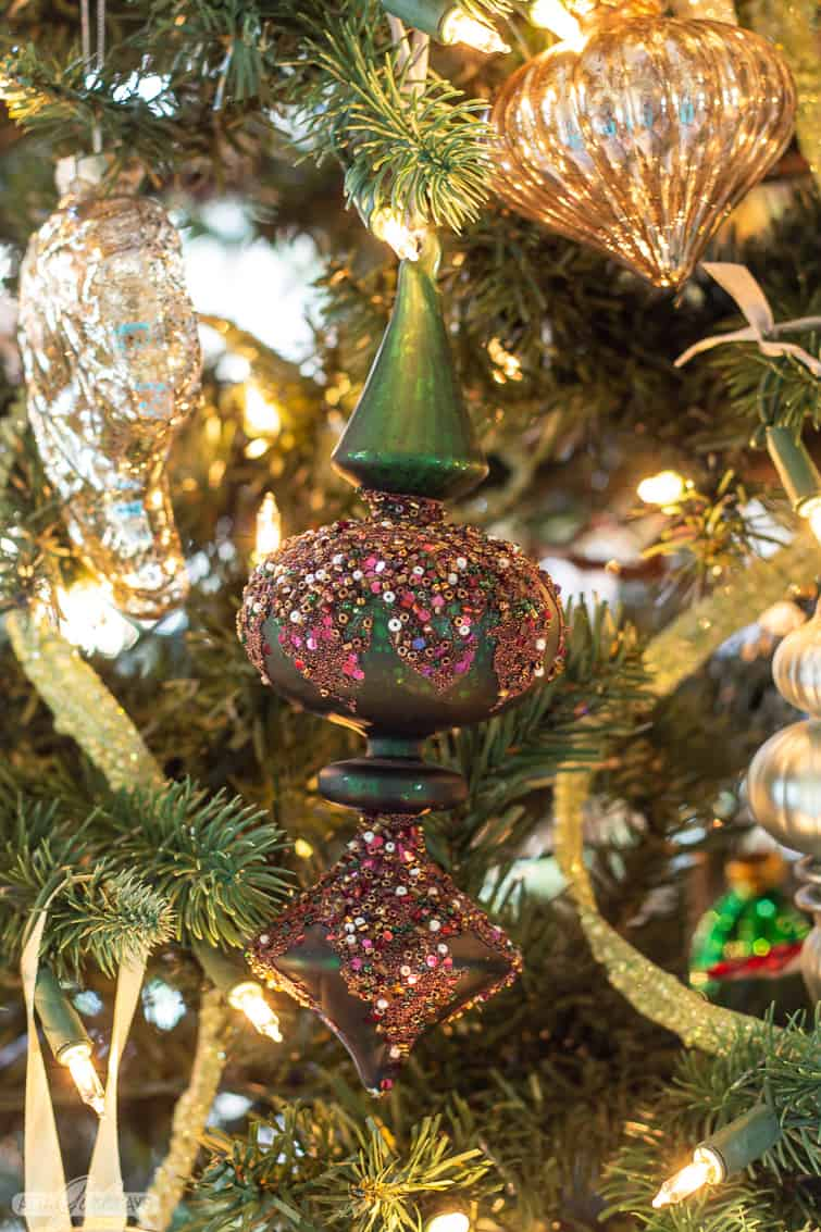 green beaded finial glass ornament on a Christmas tree