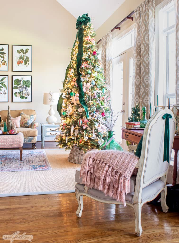 9 foot elegant Christmas tree decorated with glass ornaments and green velvet ribbon