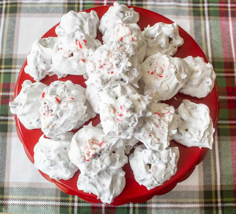 peppermint chocolate forgotten cookies on a red cake stand