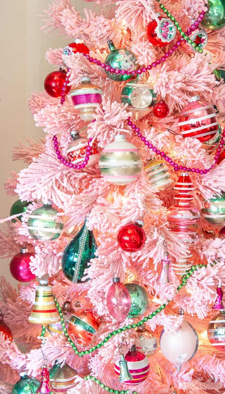 vintage ornaments on a pink flocked Christmas tree